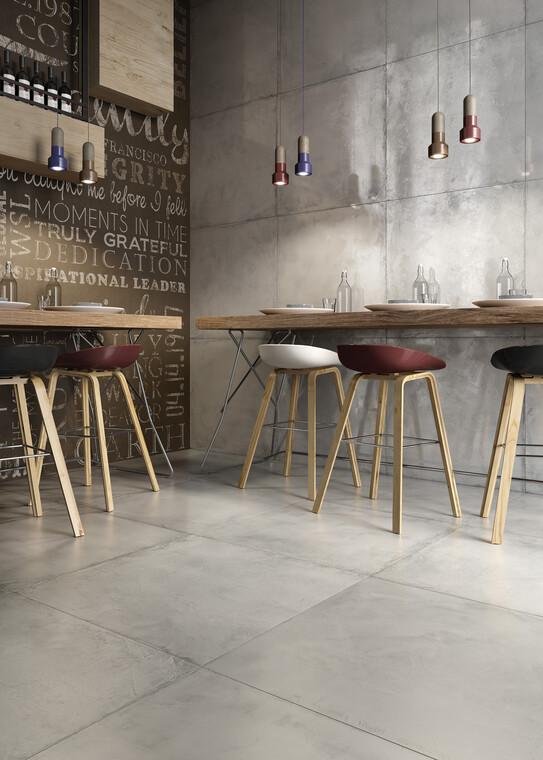 Suurikokoiset betonia muistuttavat laatat luovat tilaan trendikästä teollistyylistä tuntua