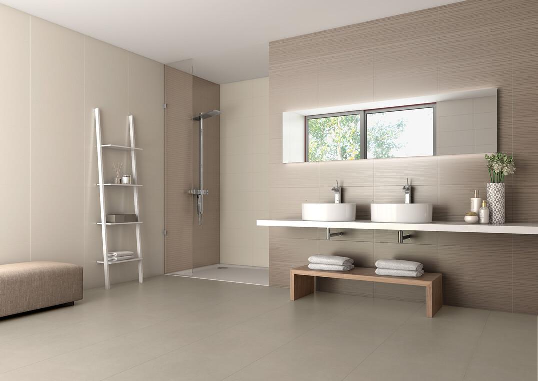 Ruskeasävyisten laattojen harmonia luo kylpyhuoneeseen hillityn modernin ilmeen