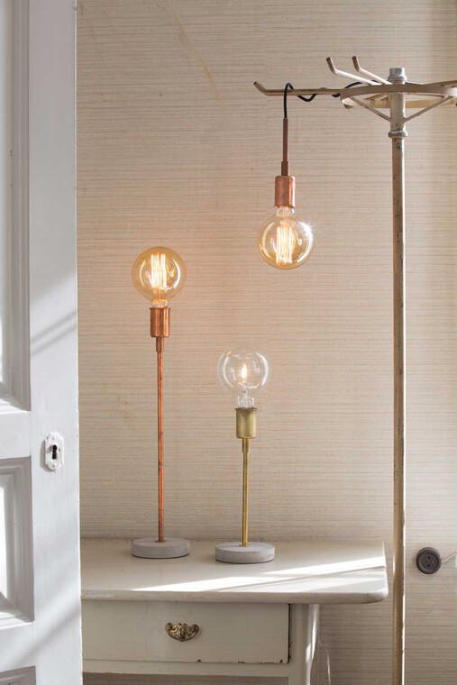 Metallisilla valaisimilla voi luoda erilaisia tunnelmia kodin eri tiloihin