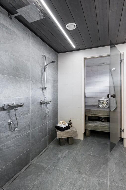 Modernia ilmettä harmaassa kylpyhuoneessa