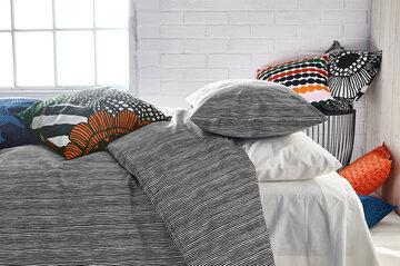 Kauniita kuoseja makuuhuoneen tekstiileissä