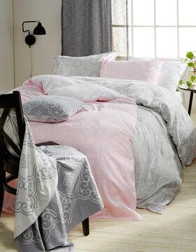Kauniita kuvioita makuuhuoneen tekstiileissä