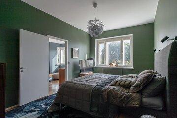 Vihreät seinät makuuhuoneessa