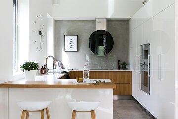 Betoniseinä tyylikkään modernissa keittiössä