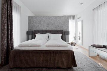 Hotellimaisen ylellistä tunnelmaa makuuhuoneessa