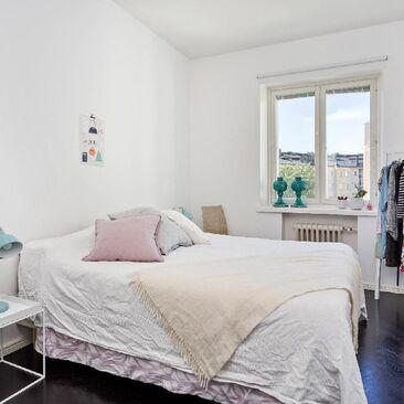 Hempeitä sävyjä makuuhuoneen väripilkkuina