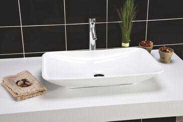 Valkea, pelkistetyn elegantti pesuallas täydentää kylpyhuonesisustuksen