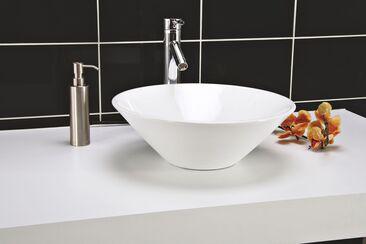 Pyöreä muotokieli toistuu kylpyhuonesisustuksen yksityiskohdissa