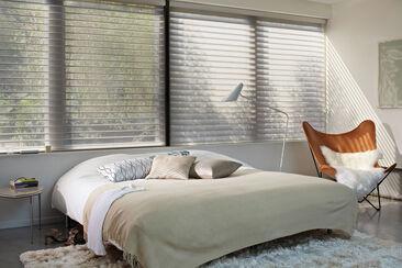 Lempeä ilme makuuhuoneeseen pehmeillä tekstiileillä