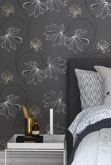 Harmaan sävyjen ja valkoisen yhdistelmä luo makuuhuoneeseen seesteisen rauhallista tunnelmaa