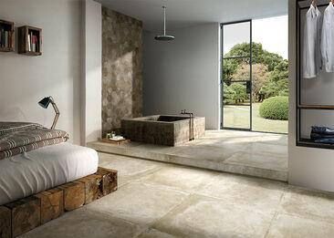 Rouheat betonilaatat yhdistyvät tyylikkäästi luonnonmateriaaleihin