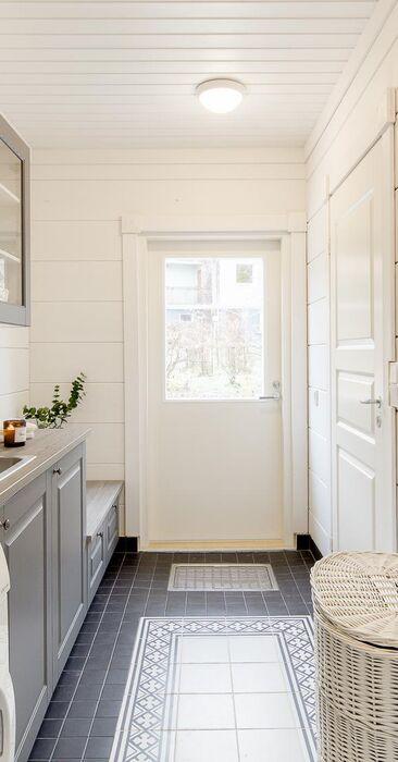 Kaunis ja käytännöllinen kodinhoitohuone